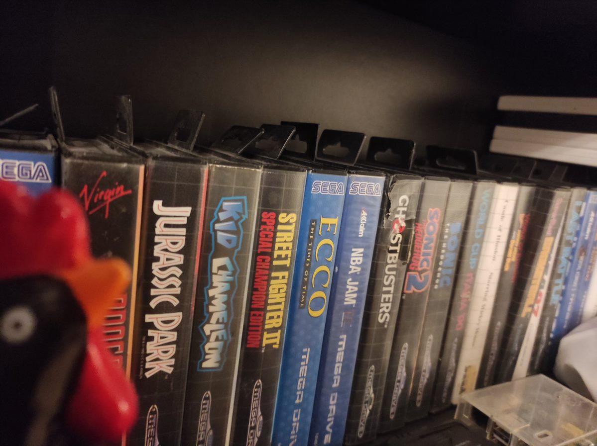 lots of Mega Drive games on book shelf