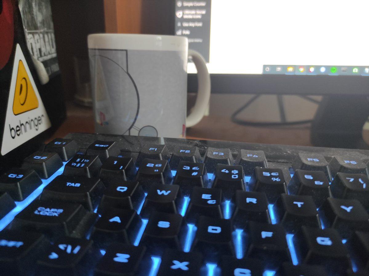 keyboard with a PS1 coffee mug