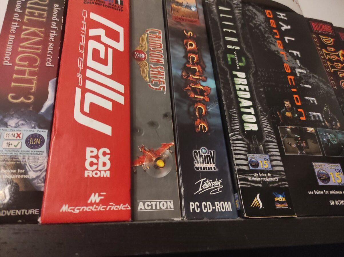 PC big box games stacked on shelf
